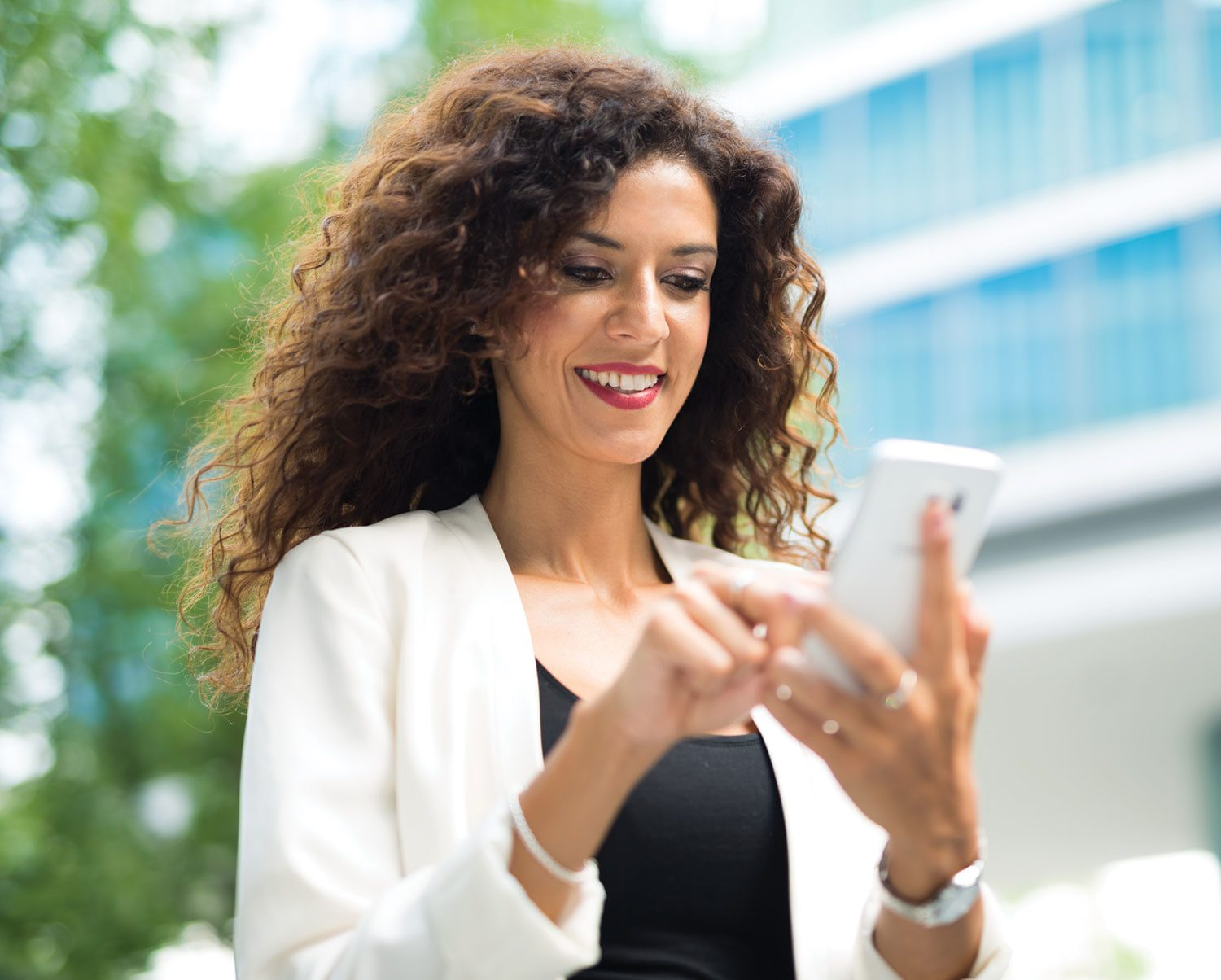 Woman checking security system on phone